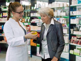 Community pharmacist with patient